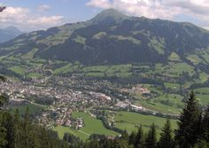 Kitzbühel is a pricey ski resort town and an old, medieval hamlet with a fairytale charm and cobblestone alleys lined with brightly painted storefronts and trendy little boutiques and cafes. Snowboarding, Skiing, Weekend Deals, Boarders, Travel Guide, Medieval, Romantic, 100m, River
