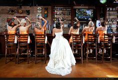 I really like is how all the bridesmaids are in a solid orange dress and the maid of honor is in floral :)
