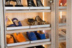 Achieve closet order for your collection of shoes with slanted shelving and our custom shoe fences. #californiaclosets #shoedisplay #shoeshelves
