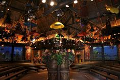 """Walt Disney's amazing Enchanted Tiki Room - the presentation features a """"cast"""" of over 150 talking, singing and dancing birds, flowers, tiki drummers and tiki totem poles that perform the attraction's signature tunes, 'The Tiki Tiki Tiki Room' by the Sherman Brothers and 'Let's All Sing Like the Birdies Sing'"""