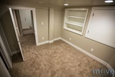 Basement Bedroom - shelves built into wall as well as lighting