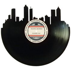 Recycled Vinyl Record Cut Into Atlanta Skyline Silhouette. Each skyline is on a record to match the city! Unique gifts for any generation. Atlanta Skyline, Record Wall Art, Men Apartment, Skyline Silhouette, Vinyl Labels, Crafts To Make And Sell, Used Vinyl, Atlanta Georgia, Aesthetic Art