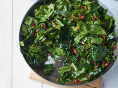 Sautéed Spring Greens with Bacon and Mustard Seeds   This quick greens sauté gets terrific flavor and texture from smoky bacon, hot chile and the pop of mustard seeds.