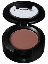 MAC Haux eyeshadow. Enhanced my brown eyes, kind of a brownish with purple undertone. Heard it's good for green too!