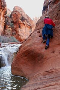 Climbing up the Moki Steps on the upper section of the Red Reef Trail Near Hurricane, Utah