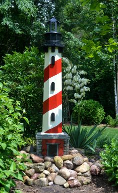 6 ft tall yard lighthouse made from leftover scrap wood and gardening rocks.  It was intended for Father's day but was kind of late...