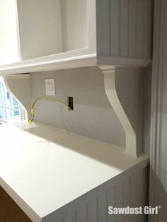 I wanted corbels that would fill the space between the upper cabinets and the base cabinets to make it appear like a single piece of furniture. These corbels are really easy to make and since I ma. Kitchen Cabinet Remodel, Kitchen Redo, Kitchen Ideas, Kitchen Cabinets, Kitchen Office, Kitchen Storage, Home Improvement Projects, Home Projects, Armoire
