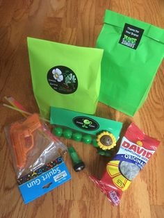 """Plants VS Zombies Themed Birthday Party for River... """"Zombie Survival Kit"""" including mini flashlight, water gun, glow sticks, Plants VS Zombie figurine (purchased in bulk off Amazon), sunflower seeds, and 'Zombie Ammo' for the pea shooter (gum-balls).  Complete with homemade labels."""