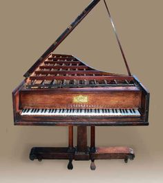 Stodart, London, ca. 1820  A rare 'Compensator Grand' by this fine maker. Rosewood case and exceptional Empire stand. 6 ½ octaves. 7'10""