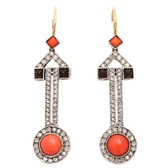 art deco earrings...white gold, diamonds, coral, and onyx.