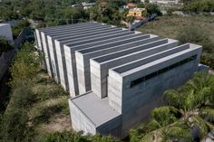 The project is laid out on two levels. A partially sunken lower floor is accessible directly from the street, and contains a multi-purpose room and the ossuaries at the back of the space, which are meant to be the most private areas of the building. Outdoor Decor, Outdoor Furniture, Outdoor Spaces, Travertine, Dezeen, Minimalist, Cleaning White Walls, Mexico, Koi Fish Pond
