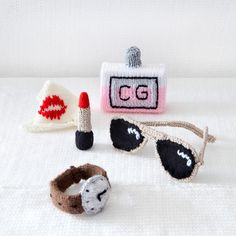 knitted lipstick, sunglasses, watch and perfume