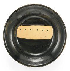 Lucio Fontana 1899 - 1968 CONCETTO SPAZIALE SIGNED AND DATED 57, GLAZED TERRACOTTA firmato e datato 57 terracotta smaltata diam. cm 28,3