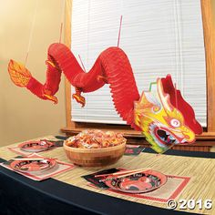 Dragon Decoration. This tissue dragon decoration makes a bold statement at any Eastern-theme party! It's a must-have at your Chinese New Year party! This ...