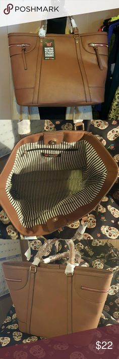 Justfab nwt hampton tote bag. Brown bag tote made by just fab 18 inches by 12 inches by 6 inches very nice larger bag new with tags never used each side has a gold zipper pocket. No shoulder strap Bags Totes
