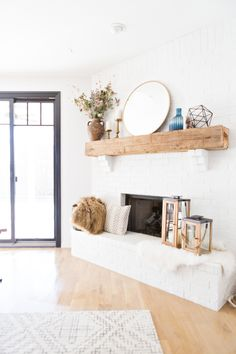 Tulsa-Remodel-Reveal-Modern-White-Farmhouse-black-windows-and-doors-white-brick-fireplace-wood-beam-mantle-gold-round-mirror-shop room ideas Wood Mantle Fireplace, Brick Fireplace Makeover, White Fireplace, Farmhouse Fireplace, Fireplace Remodel, Fireplace Design, Farmhouse Windows, Fireplace Ideas, White Brick Fireplaces