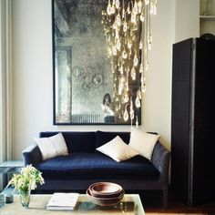ochre chandelier and antiqued glass mirror from Ochre Soho NYC. Want to hang in stair case