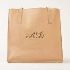 By purchasing this product you are joining a unique collaboration focused on social business impact. Learn more  Very In Fashion Leather with Customized Monogram Tote  $157.28  by AlidaTravelGear  - custom gift idea