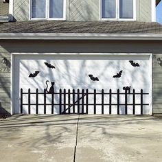 I never know what to do with the garage door... The fence could be done with black duct tape, and the bats and cats out of black construction paper?