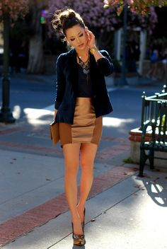 Beige and camel paneled skirt; navy blue velvet blazer