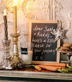 Leaving a note for Santa on a chalkboard...simple yet adorable:)