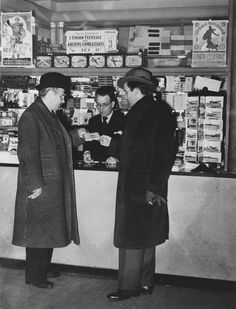 """William L. Shirer and Edward R. Murrow buying cigarettes, circa 1940. Two of the """"Murrow Boys""""  - a group of foreign correspondents during World War 2"""