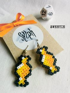 Yellow and orange 8bit Sweetie pixelart earrings with a retro vibe made of Hama Mini Perler Beads, perfect for candy fans! by SylphDesigns on Etsy
