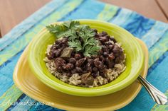 Slow Cooker Cuban-Style Black Beans and Rice - not as tasty as the stovetop variety but so much faster. Adding rice makes this fill a 6 qt tub. Add bacon next time. Great w/ tortillas & salsa