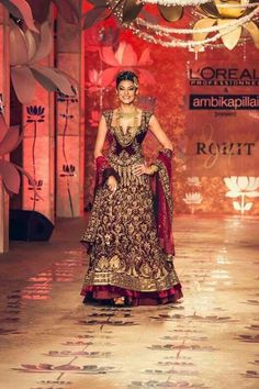 Sushmita Sen in a traditional red lengha for Rohit Bal