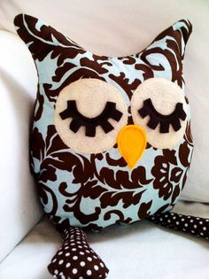 lovely sleepy owl pillow-would be cute if it had a more subtle pattern