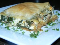 Our Version of Spanikopita with Fresh Spinach, Garlic, Feta Cheese and Hot Pork Sausage, Wrapped in Filo Dough