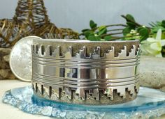 Sterling silver cuff bracelet by renowned Navajo silversmith Kee Yazzie Jr.  This bracelet is decorated with applied Kiva Step details on a darkened, highly textured background.