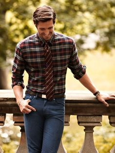 Consider teaming a dark red check button-down shirt with charcoal skinny jeans to effortlessly deal with whatever this day throws at you.  Shop this look for $73:  http://lookastic.com/men/looks/charcoal-skinny-jeans-dark-brown-belt-burgundy-tie-burgundy-longsleeve-shirt/4375  — Charcoal Skinny Jeans  — Dark Brown Leather Belt  — Burgundy Vertical Striped Tie  — Burgundy Plaid Longsleeve Shirt