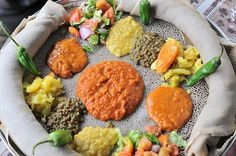 An appetizing and healthful Ethiopian spread on the edible plate called Injera.