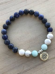 Sodalite Bracelet, Howlite Bracelet, Amazonite Bracelet This beautiful bracelet is made of 8mm Sodalite beads, 8mm White Howlite beads, 8mm Amazonite Beads, mini silver flower spacers, silver spacers and it is adorned with an adorable Lotus Flower pendant. The bracelet shown