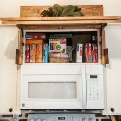 We recently learned we will be adding a babe to our family (yay!), so we've been looking for ways to add storage around our small home! Microwave Vent Hood, Hidden Microwave, Microwave Cabinet, Oven Hood, Kitchen Redo, Kitchen Remodel, Kitchen Ideas, Kitchen Cabinets, Range Hood Cover