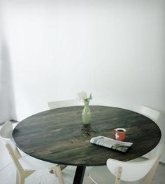 Round Reclaimed Wood Dining Table  He repurposes historic woods and other authentic relics into mid-century modern furniture and art pieces.