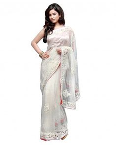 $490Look angelic with this snow white net saree. This saree will surely attract people with its pearl and diamante work Motifs are amazingly crafted with embroidery and zardozi work. Border has beautiful cut work and silver white lace adds more beauty to this saree It is a perfect example of a designer saree.    Saree will come with an unstitched blouse  Color- Snow white  Material- Net  Work- Pearl, embroidery, zardozi and diamante  Slight variation in color is possible
