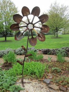 large garden art made from spade shovels