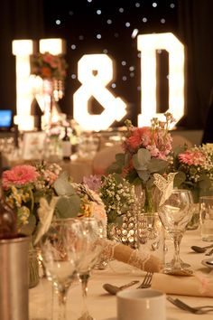 Flowers, birds, lace, and the happy couples' initials in lights...what's not to love? See more photos here: http://thebowdonrooms.co.uk/love-is-in-the-air/