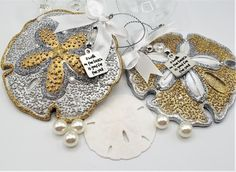 """Beach Christmas ornament.  These gorgeous sand dollar ornaments come in blingy silver or gold. These gorgeous large sand dollar ornaments match our coordinating starfish and sea horse, all blingy, sparkly, and so very festive.   They come in silver and gold designs, accented in the opposite color, with the added sparkle of a crystal beaded charm that says """"A Walk on the Beach is Good for the Soul"""".  Perfect for any beach lover! Resin.   I add a sweet little satin white bow too. 3.5""""…"""