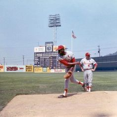 Bob Gibson warming up at Crosley Field, August 1969. Pitching coach is Billy Muffett (#4).