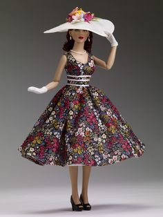 "$99.99 DeeAnna Denton ""A Day at the Races"" Tonner Doll Company Outfit only  Fits 16"" curvaceous body  Floral dress with white ribbon trim  White crinoline petticoat  White hat with faux flowers  White gloves  Faux pearl earrings  Faux pearl necklace  Black faux leather shoes  LE 200"