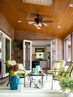 This patio is the perfect spot to read a book on a summer afternoon! More porch design ideas: http://www.bhg.com/home-improvement/porch/porch/porch-design-ideas/?socsrc=bhgpin062713skylights=2