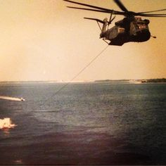 MH-53E Sea Dragon has digital flight-control system includes features specifically designed to help tow minesweeping gear. The prototype MH-53E made its first flight on 23 December 1981. MH-53E seen here testing sled tow near Panama City, Florida.