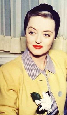Bette Davis 40s yellow jacket black turban hat striped blouse color photo snapshot movie star casual day wear glam