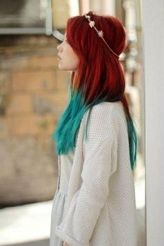 Love her red auburn hair with the blue tips. Makes me think of a really hot fire and in the center the flames are blue.