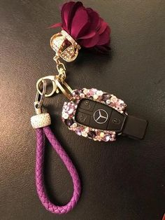 Mercedes Benz Purple Bling Car Key Holder with Rhinestones and flowers   More bling your ridecar accessories. Great quality dazzling rhinestones are used. Handmade and customized for Mercedes keys for a great fit.  Customer feedbacks: