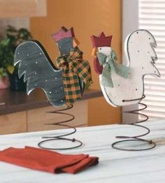 Spring chickens er, make that, roosters. Painted wood, mounted on rusty springs for bobbing touch of whimsy.
