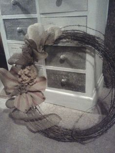 Love how this turned out. Burlap and barbed rusty wire wreath